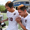 Matt Hamilton/The Daily Citizen<br /> SE10 and SE4 celebrate with the trophy.