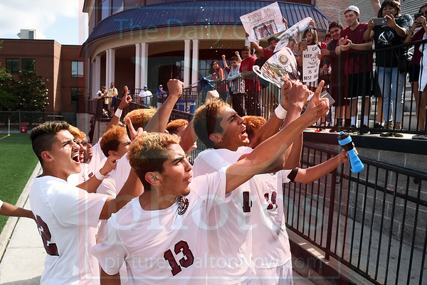 Matt Hamilton/The Daily Citizen<br /> SE players run to their fans to celebrate.