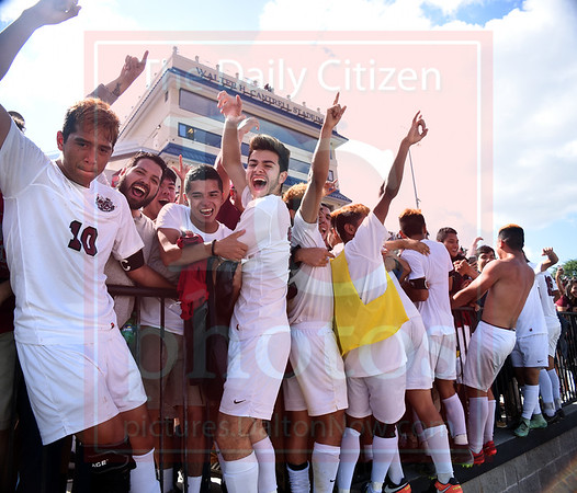 Matt Hamilton/The Daily Citizen<br /> SE players celebrate victory with their fans.