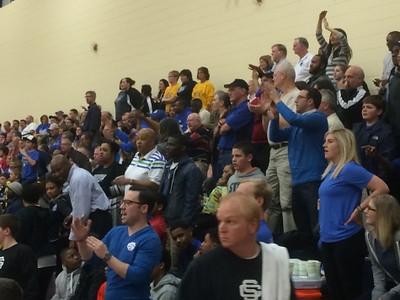 Southfield Christian fans celebrate during Tuesday's Class D quarterfinal win over Peck (The Oakland Press/Drew Ellis).