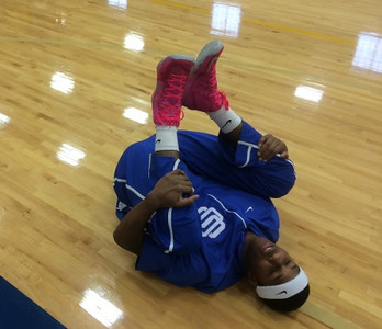 A Southfield Christian player gets loose prior to Tuesday's Class D quarterfinal (The Oakland Press/Drew Ellis).
