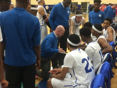 Southfield Christian coach Josh Baker speaks to the team during a time out in Tuesday's game (The Oakland Press/Drew Ellis).