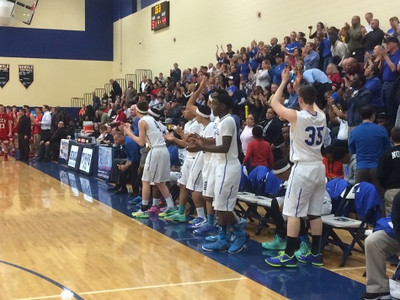 Southfield Christian players celebrate Tuesday's 61-44 win over Peck (The Oakland Press/Drew Ellis).