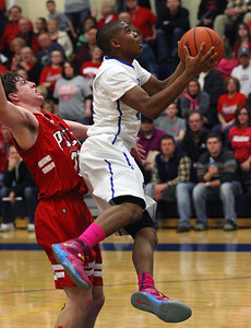 Lindsey Hunter IV, Southfield Christian, gets past defender Kyle Abrego, Peck, during boys Class D quarterfinal basketball action at Burton Bendle High School Tuesday, March 18, 2014. (Special to the Oakland Press / LARRY McKEE)