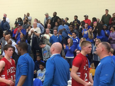 Southfield Christian fans cheer on the Eagles as they go through the handshake line with Peck (The Oakland Press/Drew Ellis).