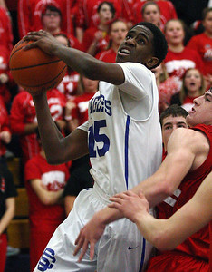 Brock Washington (15), Southfield Christian, goes up for a shot in traffic during boys Class D quarterfinal basketball action against Peck at Burton Bendle High School Tuesday, March 18, 2014. (Special to the Oakland Press / LARRY McKEE)
