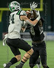 Martin DB #8 Javein Toviano reaches in to deflect to the pass as Carroll WB #14 Brady Boyd tries to make the catch.