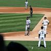 AJ Pierzynski returns to first base after a pitch as Derrek Lee guards first.
