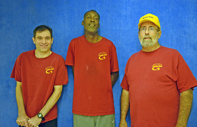 Paul Bettendorf, of Lewisburg, and Ed Reynolds, of Milton, stand with their coach Doug Heddings, of Milton, during a bowling practice for the Northumberland-Snyder County Special Olympics team. Bettendorf and Reynolds are both inducted into the PA Special Olympics Hall of Fame; Bettendorf in 2000 and Reynolds in 2010.