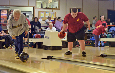 Tony Larusso and Rusty Jones bowl at Imperial Lanes in Milton during a practice for the Northumberland-Snyder County Special Olympics team on Sunday afternoon.