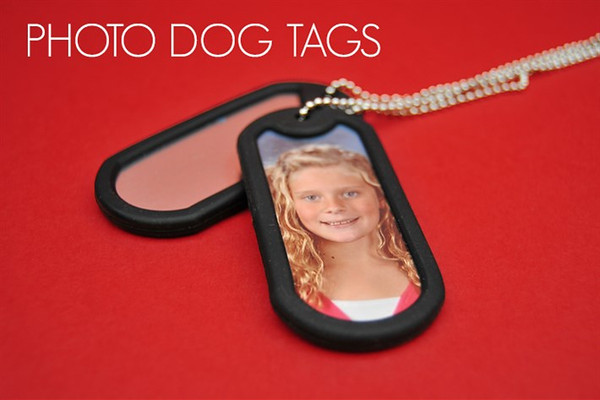 <center>~ $8.00 ~ Stay ahead of the pack with Photo Dog Tags. Printed on one side and with a black rubber border, children big and small will flip over this new way to show off their favorite sports photo</center>