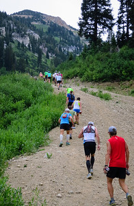 Opening miles are steep, rocky road with lots of competition.  Ryan in blue.
