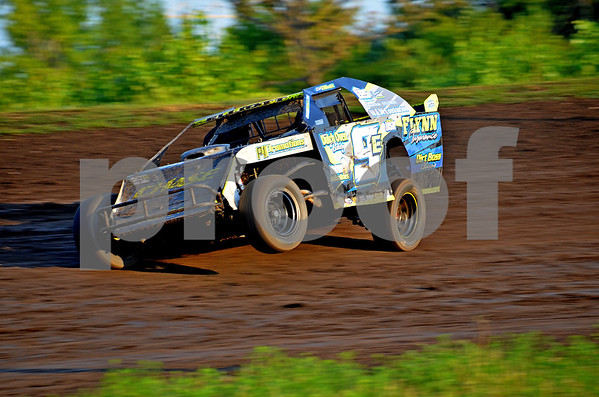 -Messenger photo by Britt Kudla<br /> Eric Elliott of Boone turns the corner at Mineral City Speedway on Sunday