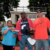 """Amanda Sprouse of the Bronx, with Con Edison volunteer event organizers Bill White and Adam Sepulveda, recites the Special Olympics Oath, """" Let me win, but if I cannot win, let me be brave in the attempt."""" at the opening ceremonies of the 2010 Freddie Allen Jr., Special Olympic Spring Games at Mount Saint Michael Academy."""