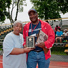 Recipient of the Norica Pizarro Volunteer of the Year Award, Nancy Romero of Morris Park poses with Con Edison volunteer event organizer Bill White at the 2010 Freddie Allen Jr. Special Olympics Spring Games at Mount Saint Michael Academy.