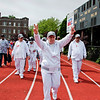 Diane Melore of SUS (Services for the Undeserved) leads fellow athletes around the track during opening ceremonies of the 2010 Freddie Allen Jr., Spring Games at Mount St. Michael Academy