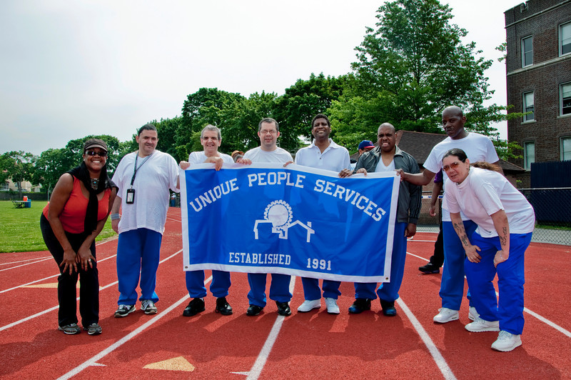 Bronx Region Special Olympic athletes from East Treamont's Unique People Services prepare to march at the opening ceremonies of the 2010 Freddie Allen Jr. Spring Games.  From left to right, UPS staffer Elousie Presidents, athletes Richard Aponte, Robert Reichenbach, Robert Toca, Charlie Farrella, Frank Shelton, Johnny Lee Brown and UPS staffer Maria Millie Gonzalez.