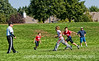 4th and 5th grade boys in a flag football game