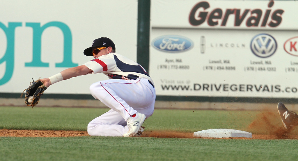 . Lowell Spinners vs Hudson Valley Renegades baseball. Spinners second baseman Grant Williams fields the throw to second as Renegades\' Tanner Dodson slides in safe with a stolen base in the top of the third inning. (SUN/Julia Malakie)