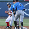 Lowell Spinners vs Hudson Valley Renegades baseball. Spinners' Andre Colon, rear, is safe at second on a bunt single by Korby Batesole, as Renegades shortstop Tyler Frank, center, and second baseman Justin Bridgman (2) converge, in the bottom of the fourth inning. (SUN/Julia Malakie)