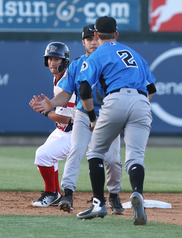 . Lowell Spinners vs Hudson Valley Renegades baseball. Spinners\' Andre Colon, rear, is safe at second on a bunt single by Korby Batesole, as Renegades shortstop Tyler Frank, center, and second baseman Justin Bridgman (2) converge, in the bottom of the fourth inning. (SUN/Julia Malakie)
