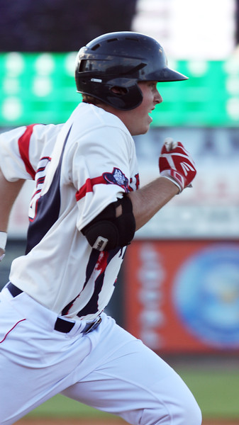 Lowell Spinners vs Hudson Valley Renegades baseball. Spinners' Tyler Esplin runs out a ground ball out in the bottom of the fourth inning. (SUN/Julia Malakie)