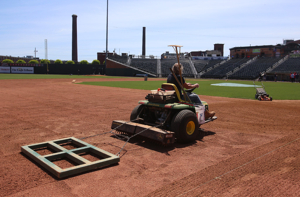 . Lowell Spinners Media Day. Smoothing the basepaths before practice. (SUN/Julia Malakie)