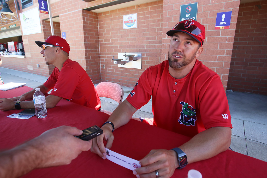 . Lowell Spinners Media Day. New manager Luke Montz, right, and hitting coach Nate Spears, left, talk to reporters. (SUN/Julia Malakie)