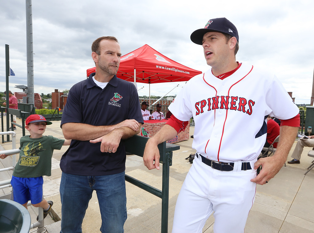 . Lowell Spinners Media Day. Catcher-turned-pitcher Danny Bethea, right, talks with Spinners chaplain Ryan Reveley of Chelmsford. At left is Reveley\'s son, Rex, 5. (SUN/Julia Malakie)