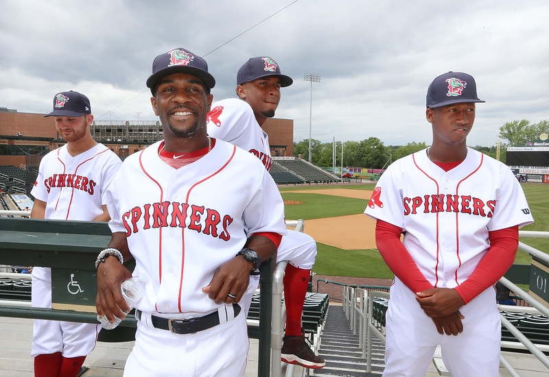 Lowell Spinners Media Day. From left, pitcher Tanner Raiburn (32), manager Corey Wimberly, and pitchers Yorvin Pantoja (57) and Alexander Montero (31). (SUN/Julia Malakie)