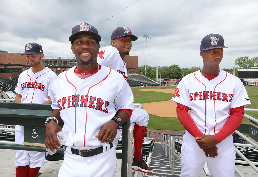 . Lowell Spinners Media Day. From left, pitcher Tanner Raiburn (32), manager Corey Wimberly, and pitchers Yorvin Pantoja (57) and Alexander Montero (31). (SUN/Julia Malakie)