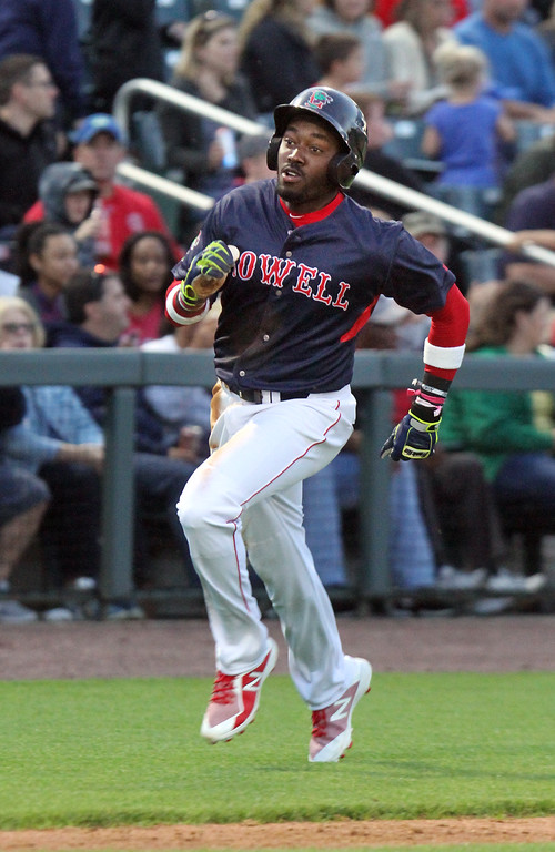 . Lowell Spinners baseball opening day game vs Connecticut Tigers. Spinners\' Xavier LeGrant (11) scores from first on a double by Nick Northcut in the bottom of the third inning.  (SUN/Julia Malakie)