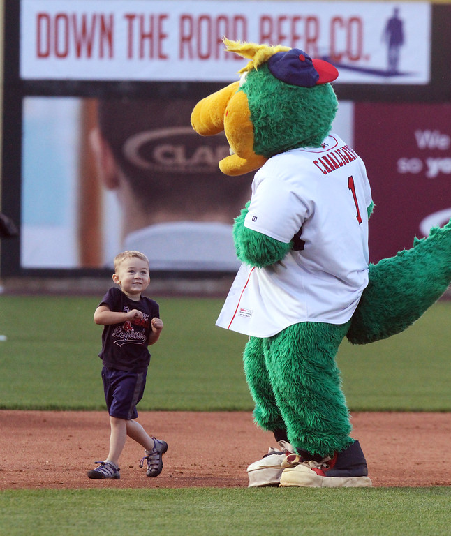 . Lowell Spinners baseball opening day game vs Connecticut Tigers. Zach Lindof, 3, of Dracut, races the Canaligator around most of the bases before skipping home plate and heading back to his family. (SUN/Julia Malakie)