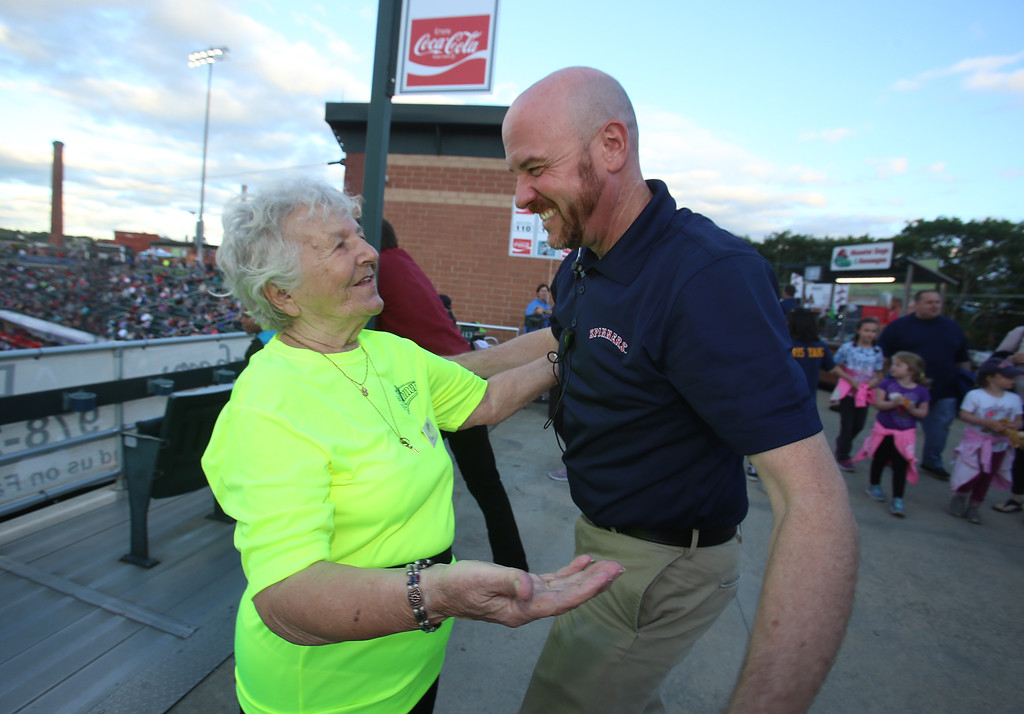 ". Lowell Spinners baseball opening day game vs Connecticut Tigers. Dottie Gendreau, who turned 89 this May and has been ushering since 2007, greets Spinners general manager Shawn Smith. Gendreau said her kids didn\'t want her to usher this season, but ""what else am I going to do, sit at home?\"" so she signed up this morning. (SUN/Julia Malakie)"