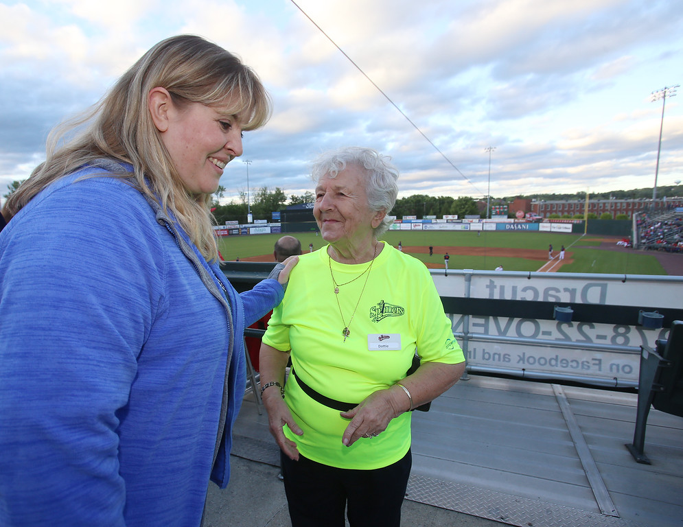 ". Lowell Spinners baseball opening day game vs Connecticut Tigers. Gwen Anderson of Maynard, left, gets directions from usher Dottie Gendreau, who turned 89 this May and has been ushering since 2007. Gendreau said her kids didn\'t want her to usher this season, but ""what else am I going to do, sit at home?\"" so she signed up this morning. (SUN/Julia Malakie)"