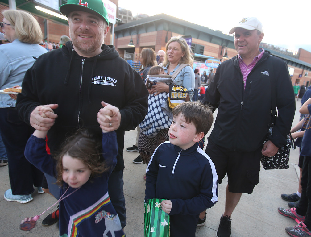 . Lowell Spinners baseball opening day game vs Connecticut Tigers. Gene Kaminsky with daughter Lydia Penelope, 5, and son Parker Kaminsky, 7, front, and friends Fran and Ciaran McGuiness and baby brother Brody, 5 months, rear. All are from Andover.  (SUN/Julia Malakie)