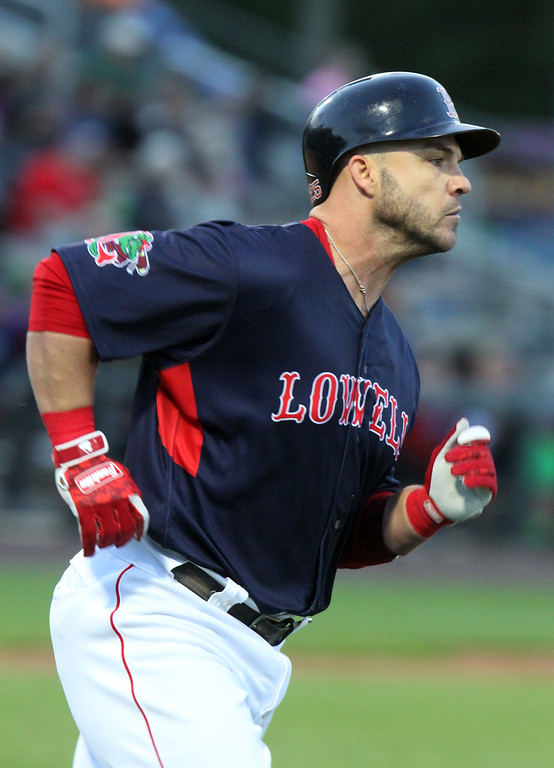. Lowell Spinners baseball opening day game vs Connecticut Tigers. World Series MVP Steve Pearce (51), rehabbing with the Spinners, runs to first after hitting a double in the bottom of the third inning.(SUN/Julia Malakie)