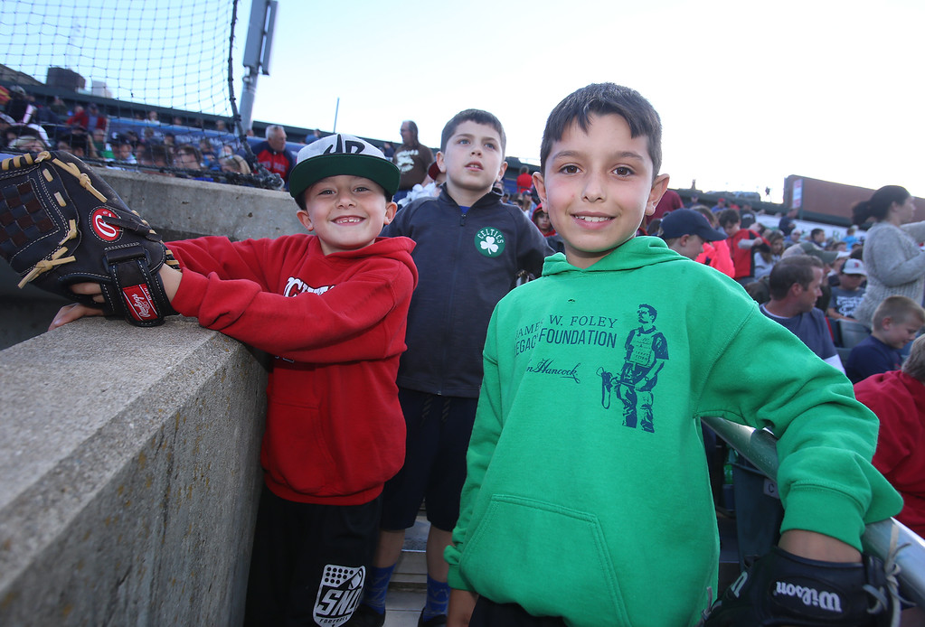 . Lowell Spinners baseball opening day game vs Connecticut Tigers. Liam St. Hilaire, 7, left, his brother Dylan St. Hilaire, 8, right, and their friend Will LeCam, 7, all of Reading, were hoping to catch some foul balls on the third base side. (SUN/Julia Malakie)