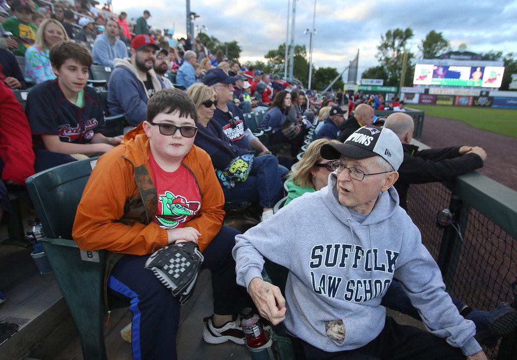 . Lowell Spinners baseball opening day game vs Connecticut Tigers. Owen McMahon, 13, of Dracut, with his grandfather Gerald McMahon, also of Dracut.  (SUN/Julia Malakie)