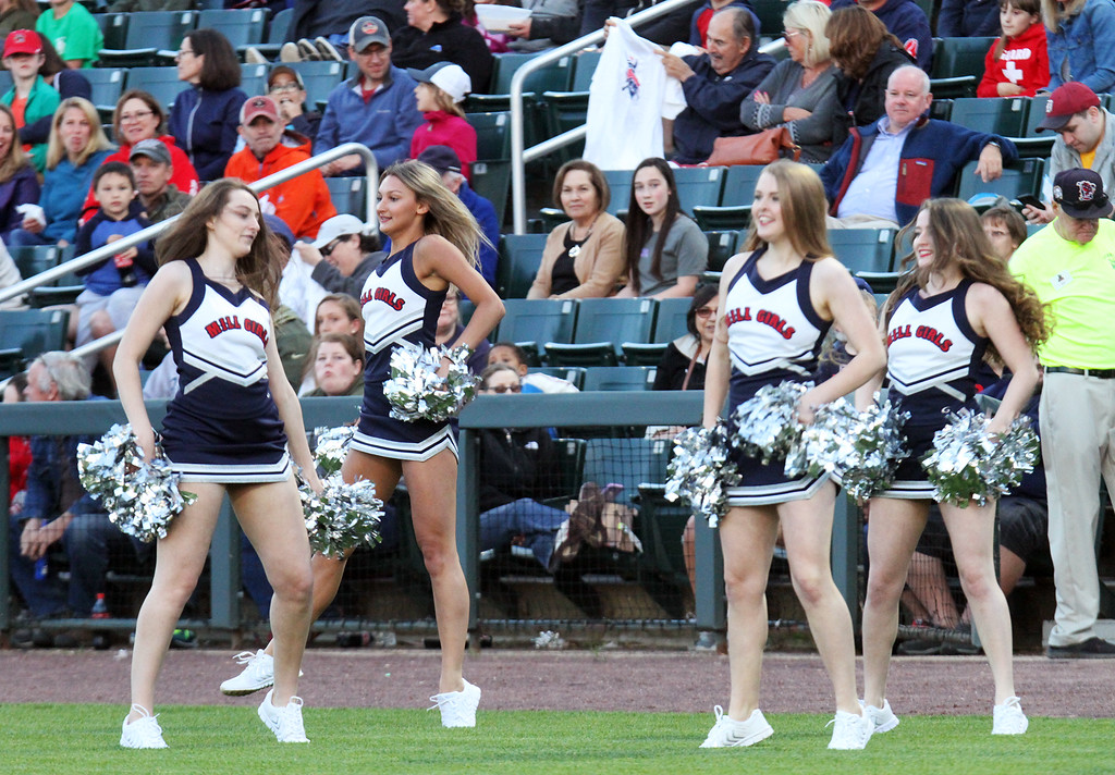 . The Mill Girls dance between innings during Lowell Spinners baseball opening day game vs Connecticut Tigers.  (SUN/Julia Malakie)