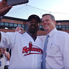 Former Red Sox DH and first baseman Sam Horn does a selfie with Gov. Charlie Baker before the Lowell Spinners game at LeLacheur Park. (SUN/Julia Malakie)