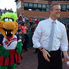 Charlie Baker gets ready to throw out one of the first pitches at the Lowell Spinners game at LeLacheur Park. At left is Allie-Gator of the Spinners mascot family. (SUN/Julia Malakie)