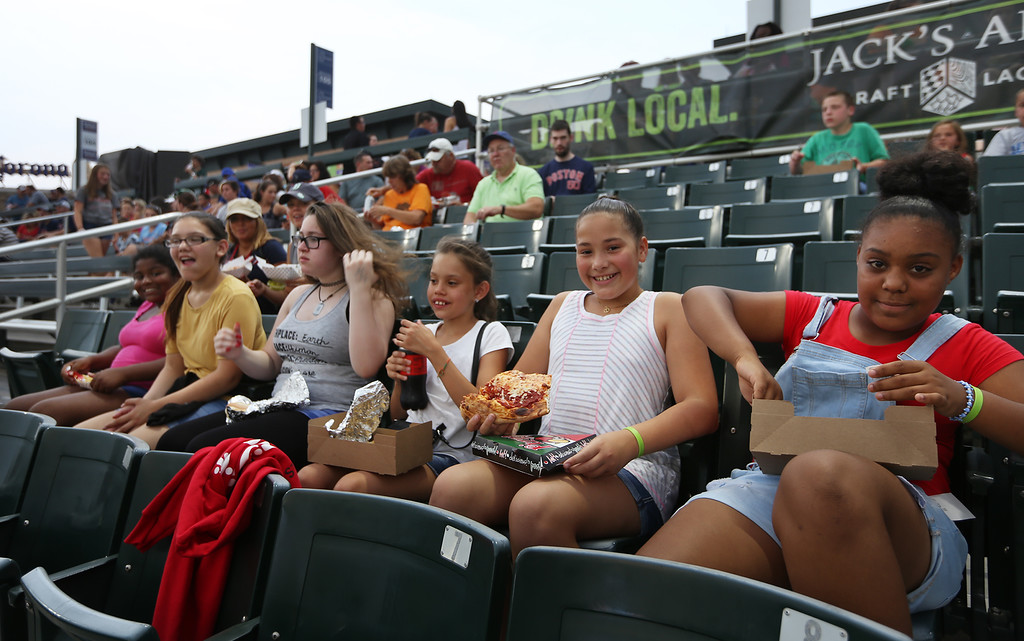 . Fans at Lowell Spinners. From left, Armani Buchanan, 12, Alynna Wallace, 12, Alexandra Ruiz, 13, Genesis Algarin, 10, Jenicia Gonzalez, 10, and Jaydalis Medina, 10, all of Lowell, among a group from Girls Inc. at the game.(SUN/Julia Malakie)