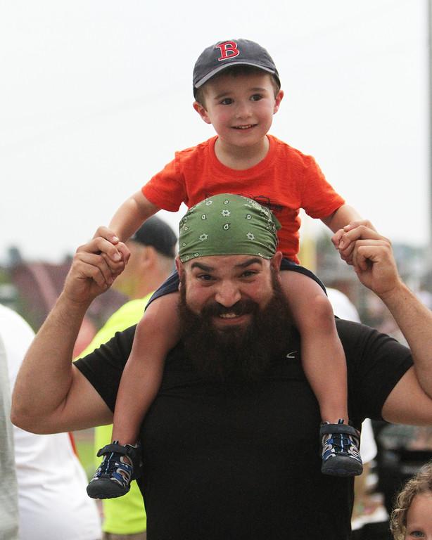 . Fans at Lowell Spinners. T.J. Catalano of Dracut carries a friend\'s son, Owen Borba, 3, of Littleton.(SUN/Julia Malakie)