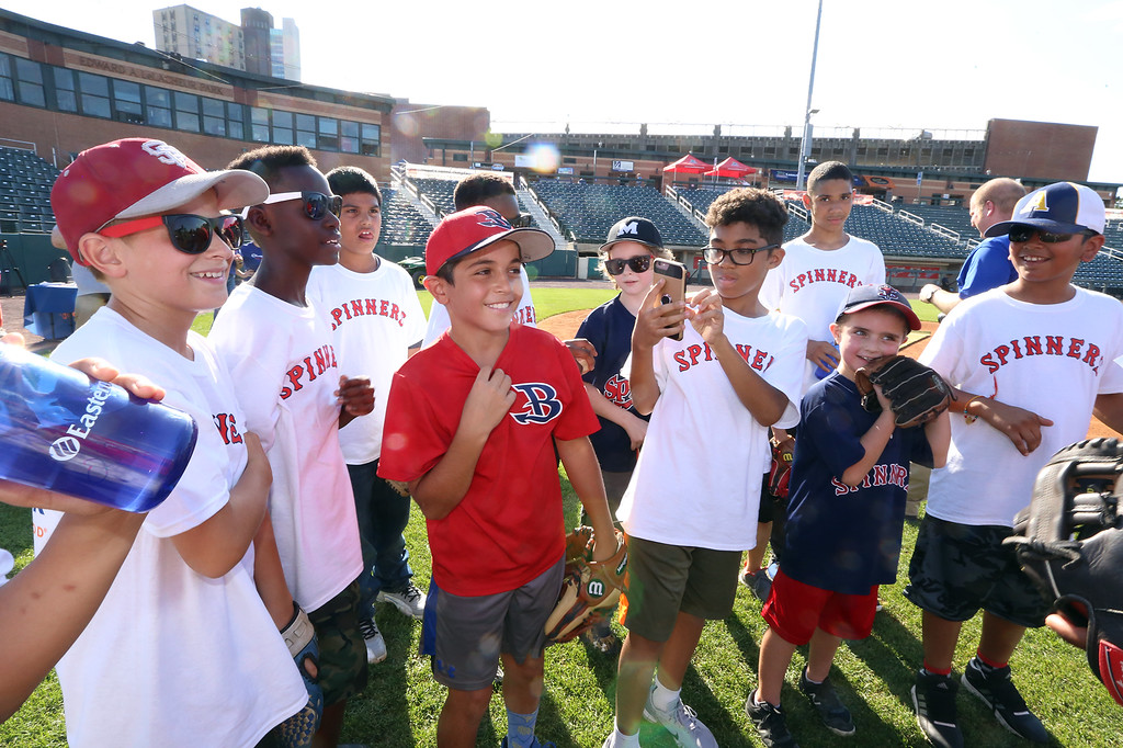 . Lowell Spinners and Eastern Bank hold kids\' baseball camp. Front from left, David Comalli, 12, of Lowell, Dominic Kasune, 11, of Lowell, Giacomo Berardinelli, 10, of Burlington, who\'d just had his name pulled out of a hat to throw out the first pitch at that night\'s Spinners game, Irwin Edwards, 11, of Lowell, Owen Bushway, 8, of Lewiston, Maine, and Aaryan Deshwal, 11, of Andover. (SUN/Julia Malakie)