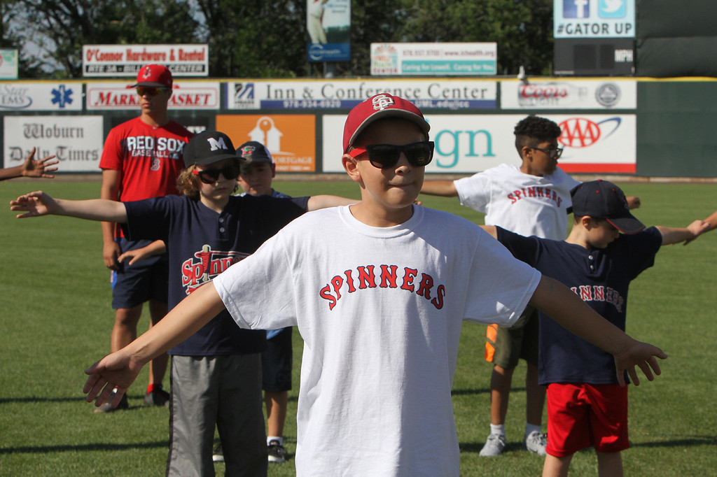. Lowell Spinners and Eastern Bank hold kids\' baseball camp. David Comalli, 12, of Lowell, during warmup exercises. (SUN/Julia Malakie)