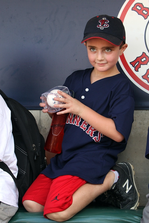 . Lowell Spinners and Eastern Bank hold kids\' baseball camp. Owen Bushway, 8, of Lewiston, Maine, holds his David Ortiz baseball, autographed in blue pen. Each kid got one. (SUN/Julia Malakie)