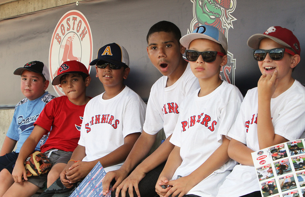 . Lowell Spinners and Eastern Bank hold kids\' baseball camp. From left, Jacob Madruga, 9, of Dracut, Giacomo Berardinelli, 10, of Burlington, Aaryan Deshwal, 11, of Andover, Jaquawn Williams, 13, of Lowell, Riley Johnson, 11, of Dracut, and David Comalli, 12, of Lowell, hear they\'ll all be getting baseballs autogphed by David Ortiz.(SUN/Julia Malakie)