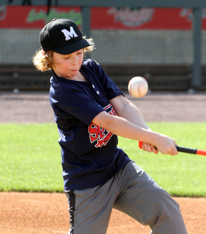 . Lowell Spinners and Eastern Bank hold kids\' baseball camp. William Fischer, 8, of Merrimack, N.H., hits during batting practice, (SUN/Julia Malakie)