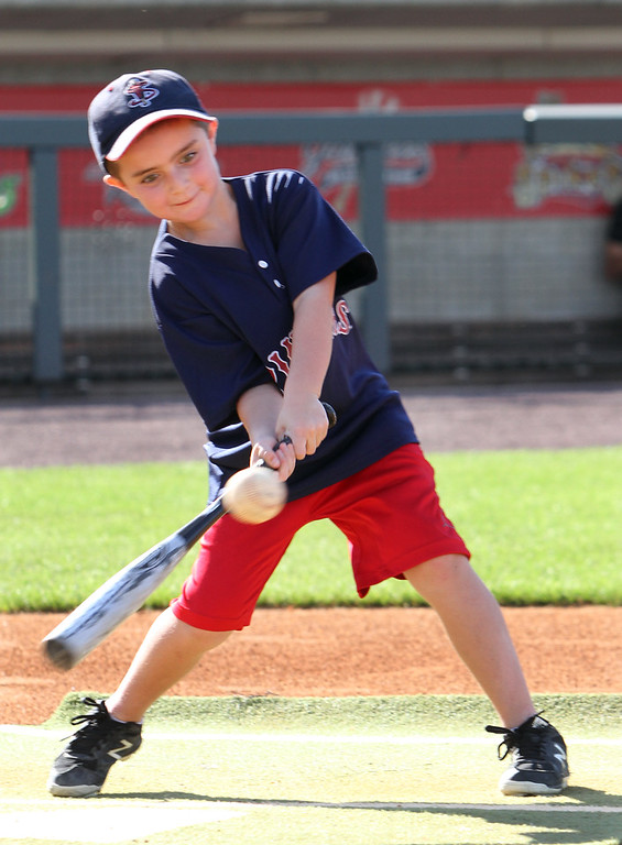 . Lowell Spinners and Eastern Bank hold kids\' baseball camp. Owen Bushway, 8, of Lewiston, Maine, during batting practice. (SUN/Julia Malakie)